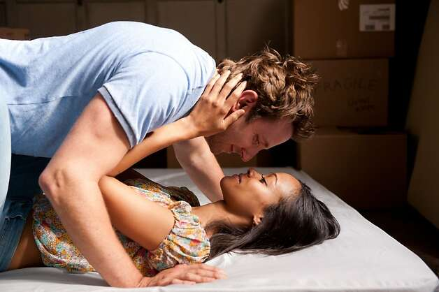 "Scenes between Bradley Cooper (as Rory Jansen) and Zoë Saldana (as his wife, Dora) give ""The Words"" a melodramatic payoff. Photo: Jonathan Wenk, CBS Films"