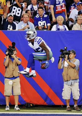 Fans watch as Dallas Cowboys wide receiver Kevin Ogletree celebrates scoring a touchdown during the second half of an NFL football game against the New York Giants, Wednesday, Sept. 5, 2012, in East Rutherford, N.J. (AP Photo/Bill Kostroun) Photo: Bill Kostroun