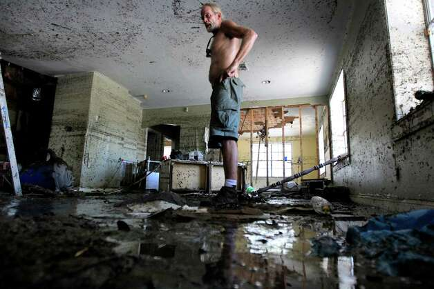 David Sellers returns to the home he was renovating after floodwaters receded from Hurricane Isaac in Braithwaite, La., Tuesday, Sept. 4, 2012. Sellers was rescued by boat during the hurricane as he and many other residents were trapped by rapidly rising floodwaters. Photo: Gerald Herbert, Associated Press / AP