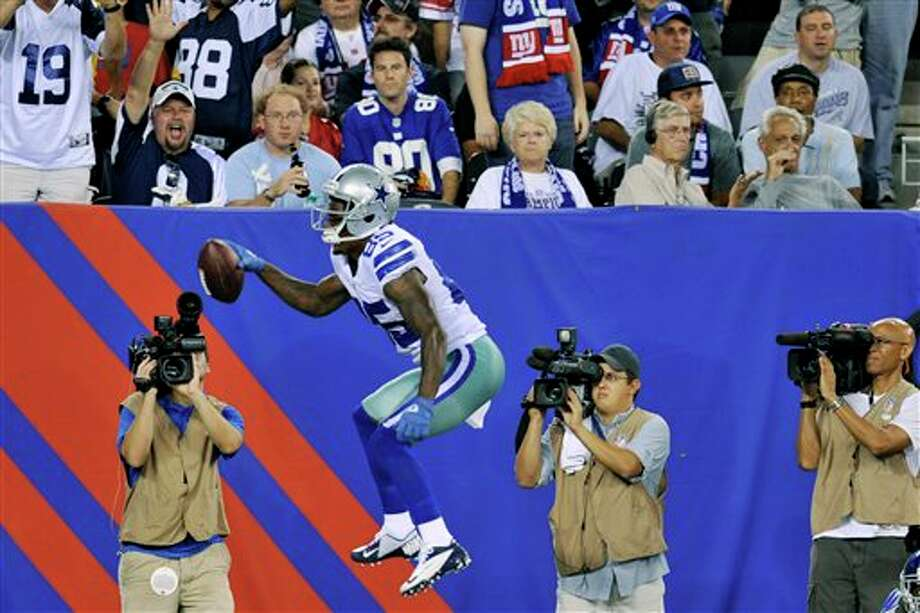 Dallas Cowboys wide receiver Kevin Ogletree (85) celebrates his touchdown during the second half of an NFL football game against the New York Giants Wednesday, Sept. 5, 2012, in East Rutherford, N.J. (AP Photo/Bill Kostroun) Photo: Bill Kostroun, Associated Press / FR59151 AP