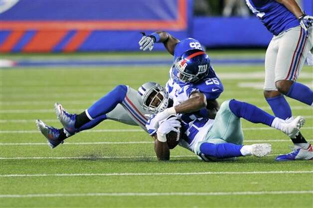 New York Giants' Antrel Rolle, top, tackles Dallas Cowboys' DeMarco Murray during the second half of an NFL football game Wednesday, Sept. 5, 2012, in East Rutherford, N.J. (AP Photo/Bill Kostroun) Photo: Bill Kostroun, Associated Press / FR59151 AP