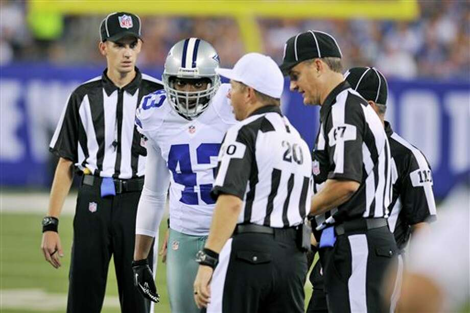 Dallas Cowboys free safety Gerald Sensabaugh (43) talks with the officials during the second half of an NFL football game against the New York Giants Wednesday, Sept. 5, 2012, in East Rutherford, N.J. (AP Photo/Bill Kostroun) Photo: Bill Kostroun, Associated Press / FR59151 AP