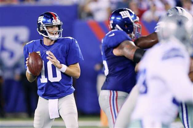 New York Giants quarterback Eli Manning looks to pass during the first half of an NFL football game against the Dallas Cowboys Wednesday, Sept. 5, 2012, in East Rutherford, N.J. (AP Photo/Seth Wenig) Photo: Seth Wenig, Associated Press / AP