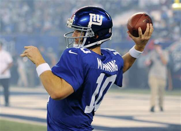 New York Giants quarterback Eli Manning throws during the first half of an NFL football game against the Dallas Cowboys Wednesday, Sept. 5, 2012, in East Rutherford, N.J. (AP Photo/Bill Kostroun) Photo: Bill Kostroun, Associated Press / FR59151 AP