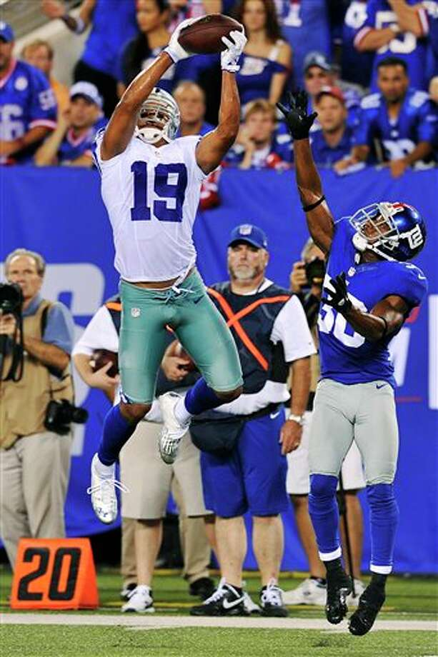 Dallas Cowboys wide receiver Miles Austin (19) catches a pass over New York Giants defensive back Justin Tryon (30) during the second half of an NFL football game, Wednesday, Sept. 5, 2012, in East Rutherford, N.J. Austin scored a touchdown on the play. (AP Photo/Bill Kostroun) Photo: Bill Kostroun, Associated Press / FR59151 AP