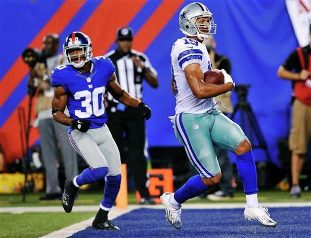 Dallas Cowboys wide receiver Miles Austin (19) scores a touchdown past New York Giants defensive back Justin Tryon (30) during the second half of an NFL football game, Wednesday, Sept. 5, 2012, in East Rutherford, N.J. (AP Photo/Bill Kostroun) Photo: Bill Kostroun, Associated Press / FR59151 AP