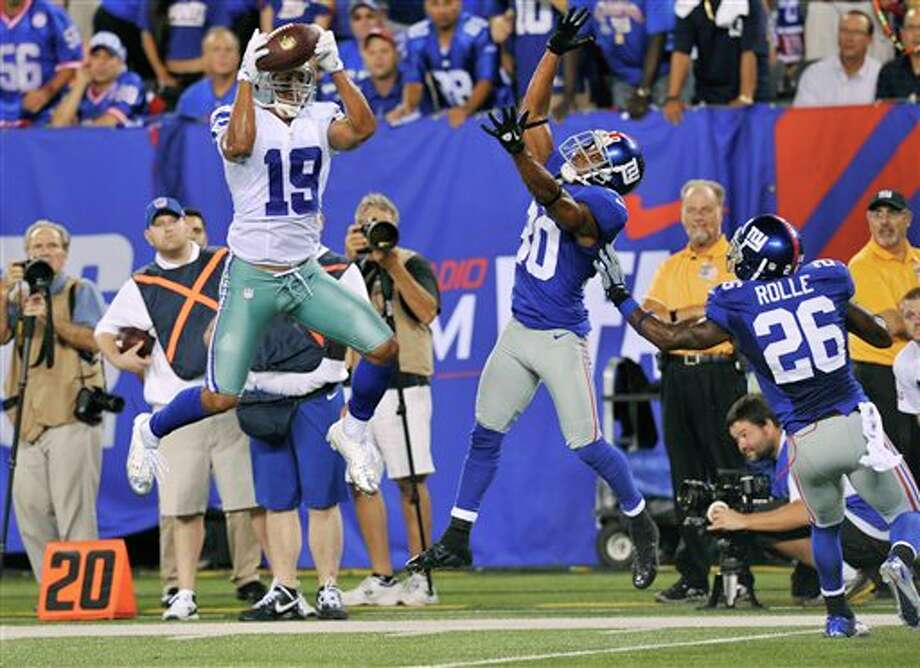 Dallas Cowboys wide receiver Miles Austin (19) catches a pass as New York Giants defensive back Justin Tryon (30) and Antrel Rolle (26) defend during the second half of an NFL football game Wednesday, Sept. 5, 2012, in East Rutherford, N.J. Austin scored a touchdown on the play. (AP Photo/Bill Kostroun) Photo: Bill Kostroun, Associated Press / FR59151 AP