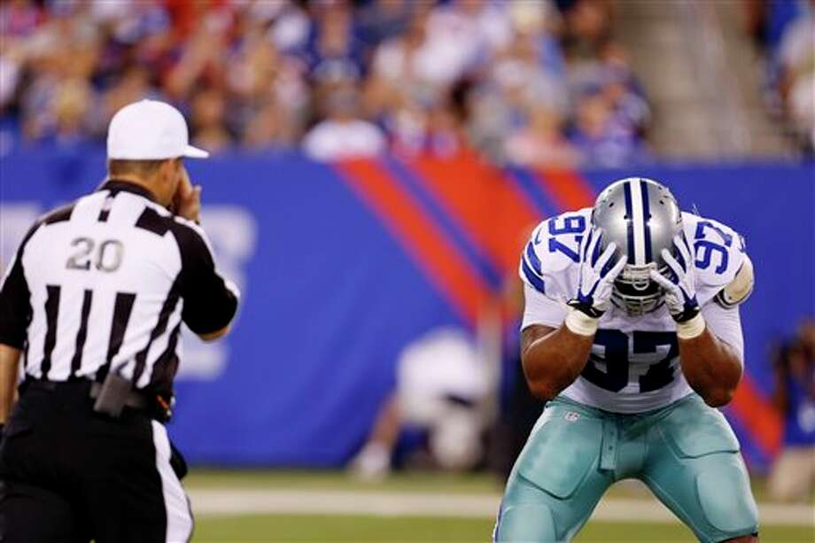 Dallas Cowboys defensive end Jason Hatcher (97) reacts to a call by Referee Jim Core during the second half of an NFL football game against the New York Giants Wednesday, Sept. 5, 2012, in East Rutherford, N.J. (AP Photo/Julio Cortez) Photo: Julio Cortez, Associated Press / AP
