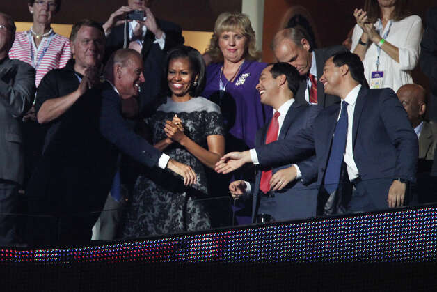 Mayor Julian Castro, right,, and his brother, Julian Castro, far right, shake hands with Vice President Joe Biden, left, with First Lady Michelle Obama before former President Bill Clinton's speech during the Democratic National Convention at Time Warner Cable Arena in Charlotte, NC on Wednesday, Sept. 5, 2012. Photo: Lisa Krantz, San Antonio Express-News / San Antonio Express-News