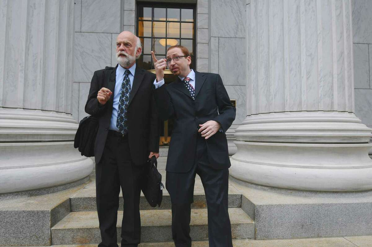 Attorney W. Andrew McCullough, left, and his client Stephen Dick, Jr., owner of Night Moves, right, emerge from the New York State Court of Appeals after arguments about taxes the state tax appeals tribunal said they owe, on Wednesday afternoon Sept. 5, 2012 in Albany, NY. (Philip Kamrass / Times Union)