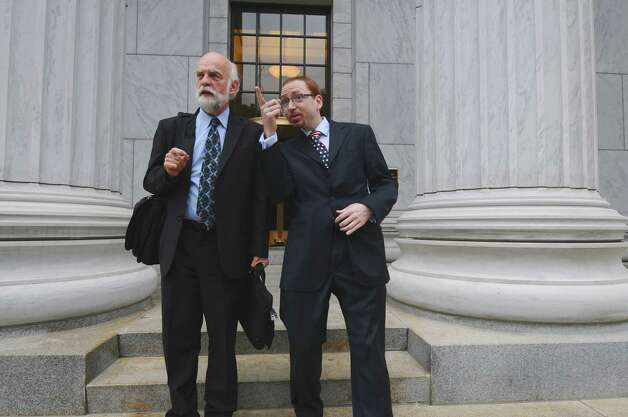 Attorney W. Andrew McCullough, left, and his client Stephen Dick, Jr., owner of Night Moves, right, emerge from the New York State Court of Appeals after arguments about taxes the state tax appeals tribunal said they owe,  on Wednesday afternoon Sept. 5, 2012 in Albany, NY.  (Philip Kamrass / Times Union) Photo: Philip Kamrass / 00019131A