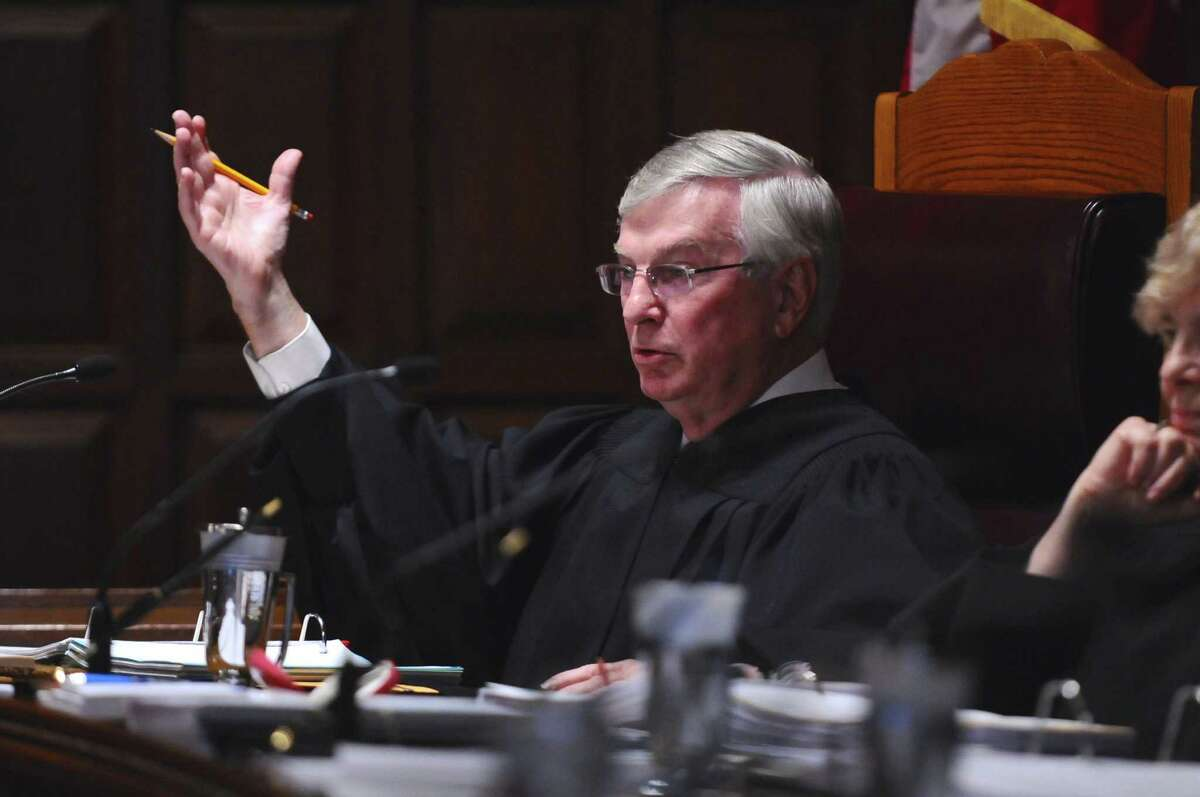 New York State Court of Appeals associate justice Eugene F. Pigott, Jr. makes a point during arguments in a case disputing whether Night Moves should have to pay certain state sales taxes, on on Wednesday afternoon Sept. 5, 2012 in Albany, NY. (Philip Kamrass / Times Union)