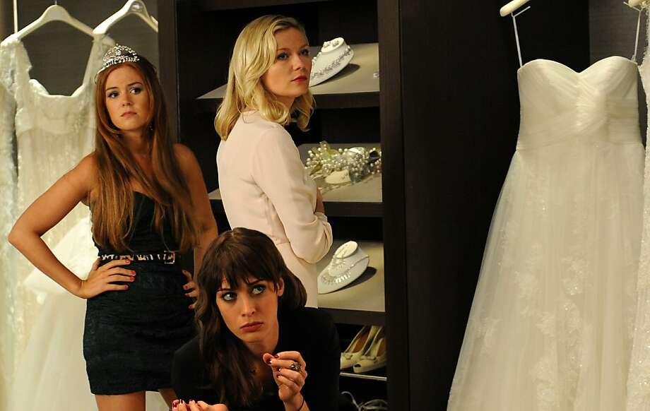 "Isla Fisher (left), Lizzy Caplan and Kirsten Dunst are the snots at the center of ""Bachelorette."" Photo: Radius-TWC"