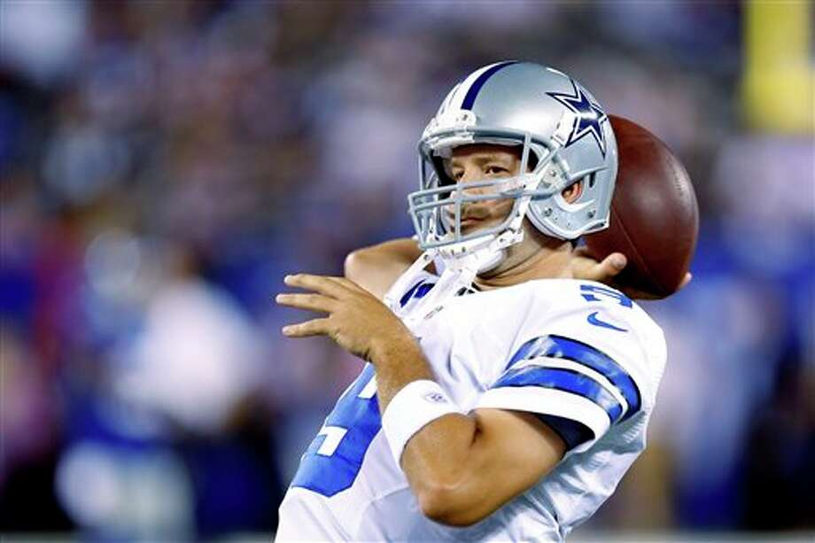 Dallas Cowboys quarterback Tony Romo warms up before an NFL football game between the New York Giants and the Dallas Cowboys Wednesday, Sept. 5, 2012, in East Rutherford, N.J. (AP Photo/Julio Cortez) Photo: Julio Cortez, Associated Press / AP