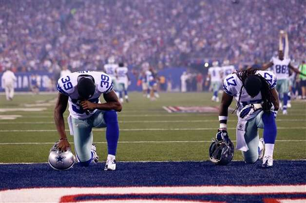 Dallas Cowboys'  Brandon Carr (39) and Dwayne Harris (17) take the field prior to an NFL football game against the New York Giants Wednesday, Sept. 5, 2012, in East Rutherford, N.J. (AP Photo/Julio Cortez) Photo: Julio Cortez, Associated Press / AP