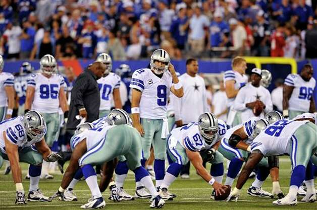 Dallas Cowboys quarterback Tony Romo (9) warms up with teammates before an NFL football game between the New York Giants and the Dallas Cowboys Wednesday, Sept. 5, 2012, in East Rutherford, N.J. (AP Photo/Bill Kostroun) Photo: Bill Kostroun, Associated Press / FR59151 AP