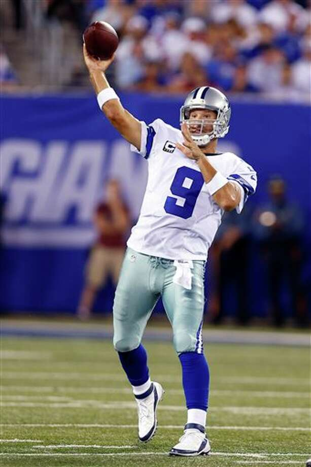 Dallas Cowboys quarterback Tony Romo throws against the New York Giants during the first half of an NFL football game Wednesday, Sept. 5, 2012, in East Rutherford, N.J. (AP Photo/Julio Cortez) Photo: Julio Cortez, Associated Press / AP