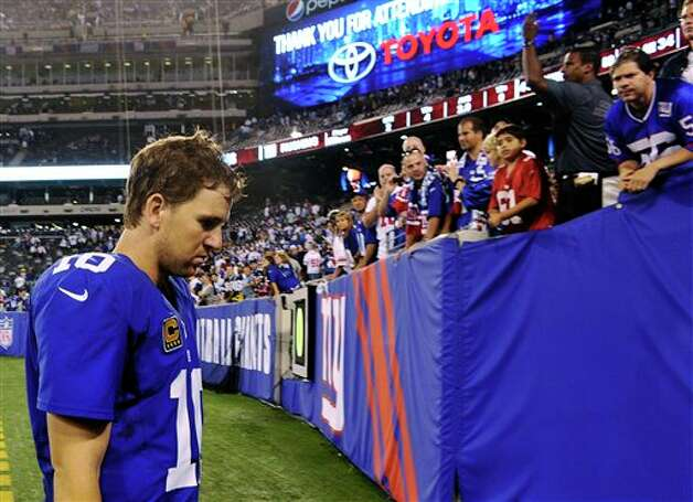 New York Giants quarterback Eli Manning (10) leaves the field after an NFL football game against the Dallas Cowboys, Wednesday, Sept. 5, 2012, in East Rutherford, N.J. The Cowboys won 24-17. (AP Photo/Bill Kostroun) Photo: Bill Kostroun, Associated Press / FR59151 AP