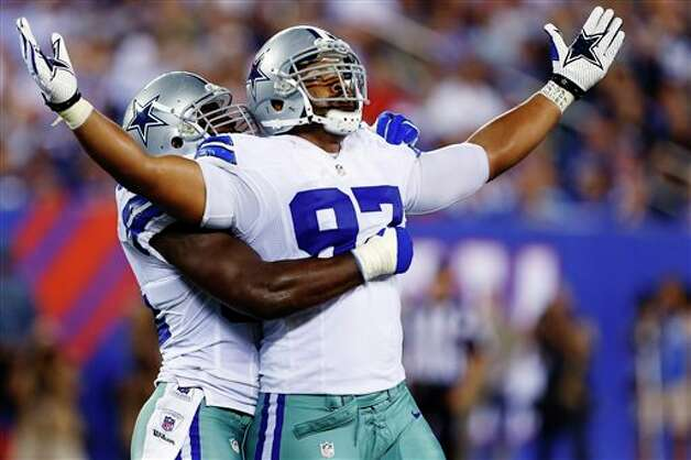 Dallas Cowboys defensive end Jason Hatcher (97) and DeMarcus Ware, rear, celebrate during the second half of an NFL football game against the New York Giants, Wednesday, Sept. 5, 2012, in East Rutherford, N.J. The Cowboys won 24-17. (AP Photo/Julio Cortez) Photo: Julio Cortez, Associated Press / AP