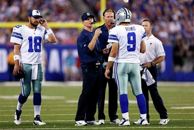 Dallas Cowboys head coach Jason Garrett, center left, talks to quarterback Tony Romo (9) during the first half of an NFL football game against the New York Giants Wednesday, Sept. 5, 2012, in East Rutherford, N.J. (AP Photo/Julio Cortez) Photo: Julio Cortez, Associated Press / AP