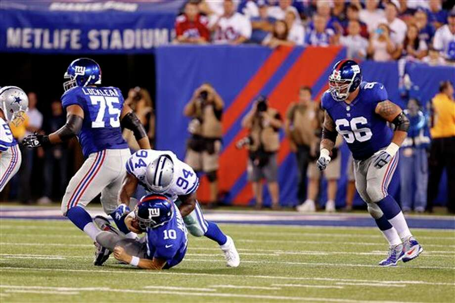 Dallas Cowboys linebacker DeMarcus Ware (94) sacks New York Giants quarterback Eli Manning (10) during the first half of an NFL football game Wednesday, Sept. 5, 2012, in East Rutherford, N.J. (AP Photo/Julio Cortez) Photo: Julio Cortez, Associated Press / AP