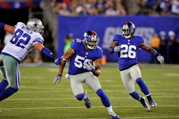 New York Giants linebacker Michael Boley (59) runs past Dallas Cowboys tight end Jason Witten (82) after intercepting a pass during the first half of an NFL football game Wednesday, Sept. 5, 2012, in East Rutherford, N.J. (AP Photo/Bill Kostroun) Photo: Bill Kostroun, Associated Press / FR59151 AP