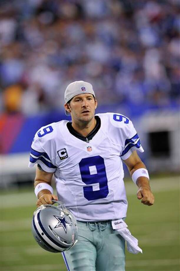 Dallas Cowboys quarterback Tony Romo leaves the field for halftime during at the NFL football game against the New York Giants Wednesday, Sept. 5, 2012, in East Rutherford, N.J. (AP Photo/Bill Kostroun) Photo: Bill Kostroun, Associated Press / FR59151 AP