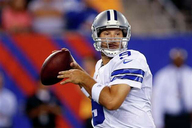 Dallas Cowboys quarterback Tony Romo looks to pass against the New York Giants during the second half of an NFL football game Wednesday, Sept. 5, 2012, in East Rutherford, N.J. (AP Photo/Julio Cortez) Photo: Julio Cortez, Associated Press / AP