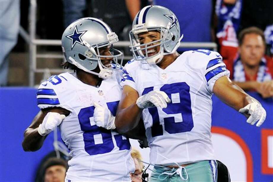 Dallas Cowboys wide receivers Miles Austin (19) and Kevin Ogletree (85) celebrate Ogletree's touchdown during the first half of an NFL football game against the New York Giants, Wednesday, Sept. 5, 2012, in East Rutherford, N.J. The Cowboys won 24-17. (AP Photo/Bill Kostroun) Photo: Bill Kostroun, Associated Press / FR59151 AP