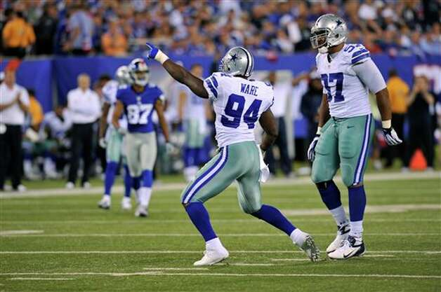 Dallas Cowboys' DeMarcus Ware celebrates his sack during the first half of an NFL football game against the New York Giants Wednesday, Sept. 5, 2012, in East Rutherford, N.J. (AP Photo/Bill Kostroun) Photo: Bill Kostroun, Associated Press / FR59151 AP