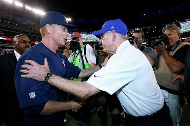 Dallas Cowboys head coach Jason Garrett, left, and New York Giants head coach Tom Coughlin shake hands at the end of an NFL football game Wednesday, Sept. 5, 2012, in East Rutherford, N.J. The Cowboys won the game 24-17. (AP Photo/Julio Cortez) Photo: Julio Cortez, Associated Press / AP