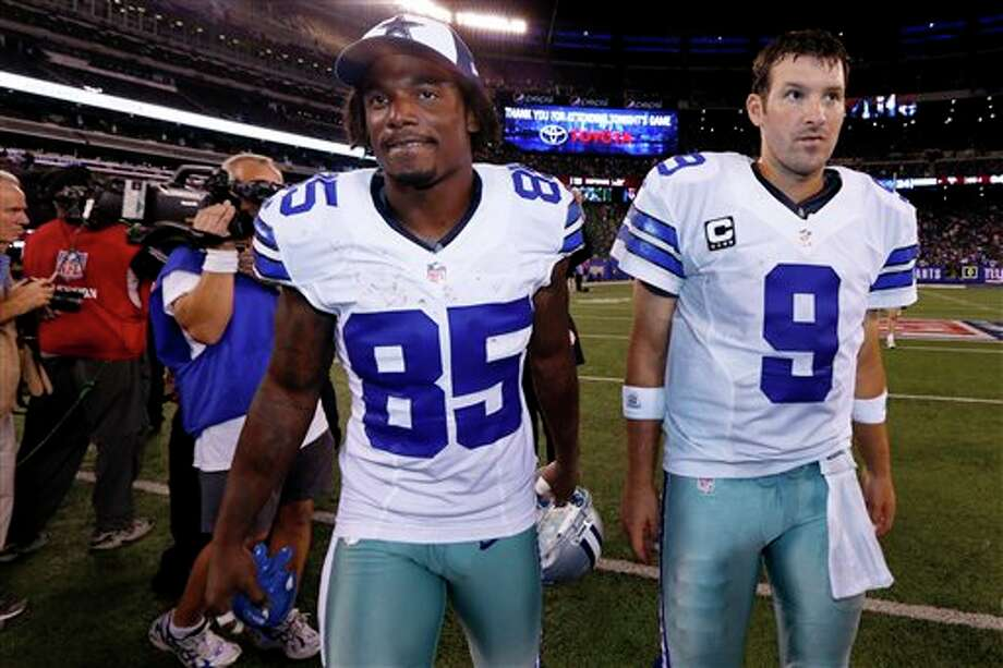 Dallas Cowboys quarterback Tony Romo (9) and teammate  Kevin Ogletree (85) leave the field after an NFL football game against the New York Giants Wednesday, Sept. 5, 2012, in East Rutherford, N.J. The Cowboys won the game 24-17. (AP Photo/Julio Cortez) Photo: Julio Cortez, Associated Press / AP