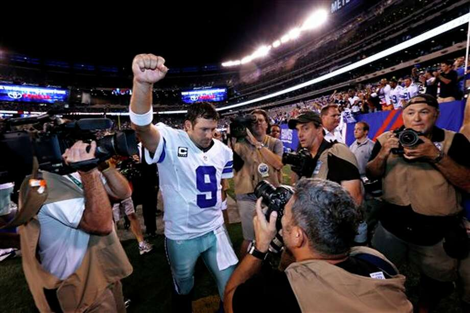 Dallas Cowboys quarterback Tony Romo walks off the field at the end of an NFL football game against the New York Giants Wednesday, Sept. 5, 2012, in East Rutherford, N.J. The Cowboys won the game 24-17. (AP Photo/Julio Cortez) Photo: Julio Cortez, Associated Press / AP