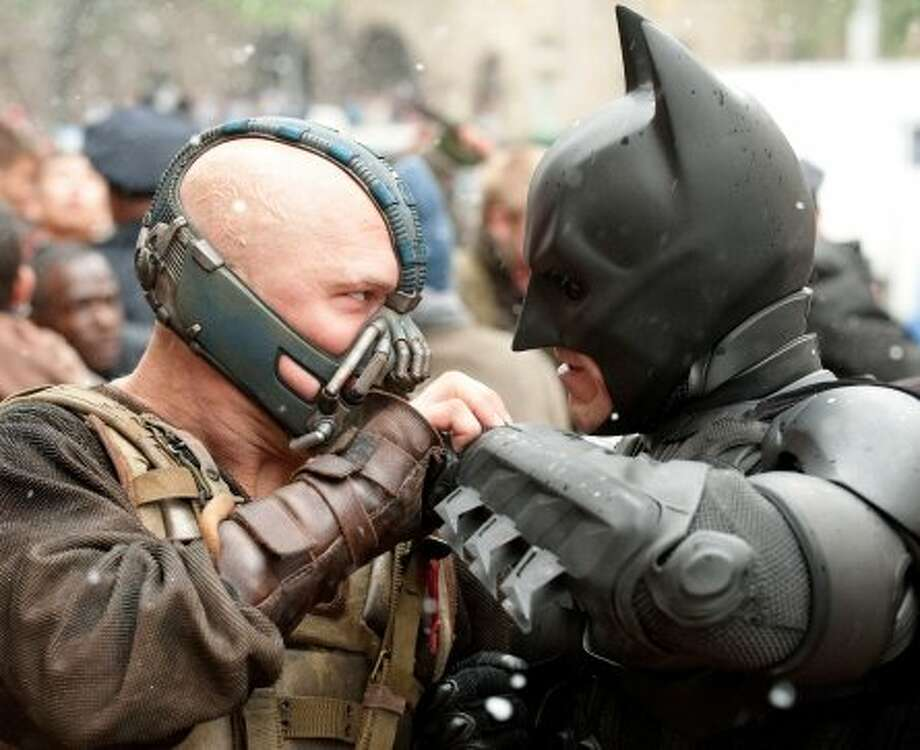 """WINNER, """"The Dark Knight Rises""""How can a movie that made this much money be considered a bit of an under-performer? Here's how: """"It will be the highest-grossing movie of summer 2012,"""" analyst Ray Subers of industry tracker BoxOfficeMojo.com predicted in May. Of course, no one could have predicted the Aurora, Colo., shootings that put a damper on things. (Warner Bros. Pictures)"""