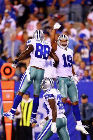 After third receiver Kevin Ogletree had most of the fun early on, Miles Austin (19) and Dez Bryant joined in after Austin's fourth-quarter score. Photo: Al Bello / 2012 Getty Images