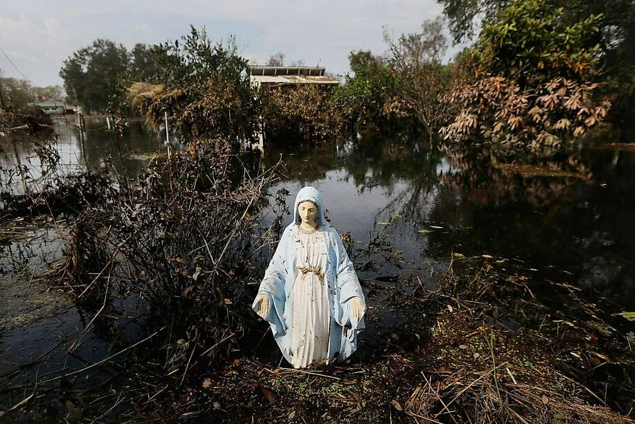A statue of the Virgin Mary stands in flood waters in Plaquemines Parish on September 5, 2012 in Braithwaite, Louisiana.  Louisiana officials estimate that at least 13,000 homes were damaged by Hurricane Isaac. Photo: Mario Tama, Getty Images