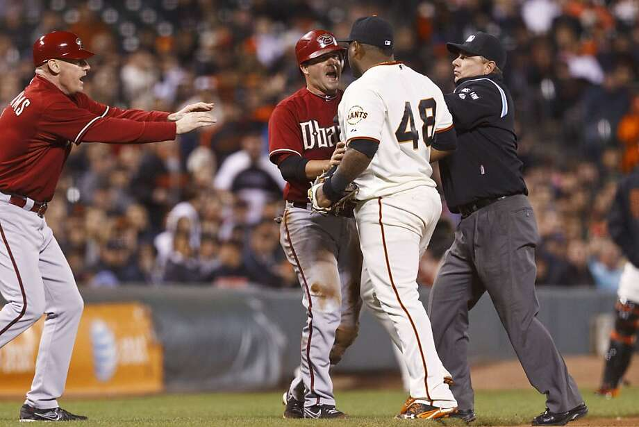 SAN FRANCISCO, CA - SEPTEMBER 05: Pablo Sandoval #48 of the San Francisco Giants and John McDonald #16 of the Arizona Diamondbacks are restrained by umpire Greg Gibson #53 (R) and third base coach Matt Williams #9 (L) during an altercation at third base during the eighth inning at AT&T Park on September 5, 2012 in San Francisco, California. (Photo by Jason O. Watson/Getty Images) Photo: Jason O. Watson, Getty Images