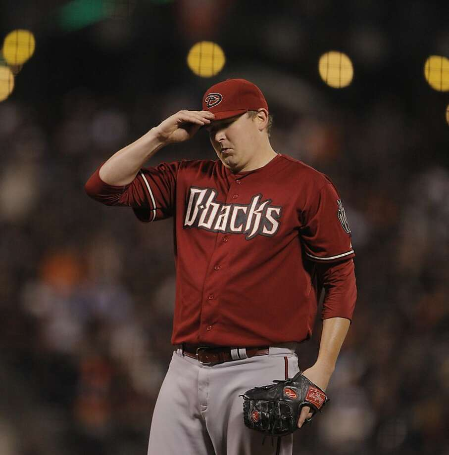 Trevor Cahill reacts to walking Brandon Crawford in the sixth inning. Cahill was perfect until the walk. The San Francisco Giants played the Arizona Diamondbacks at AT&T Park in San Francisco, Calif., on Wednesday, September 5, 2012. Photo: Carlos Avila Gonzalez, The Chronicle