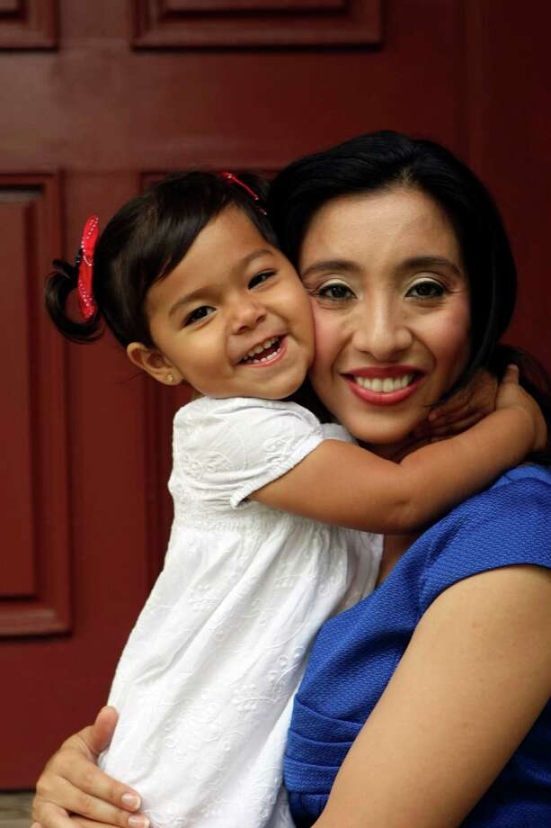 Erica Castro and her daughter Carina , 2. Erica is a working mom who is a math specialist for NISD. Photo: HELEN L. MONTOYA, San Antonio Express-News / SAN ANTONIO EXPRESS-NEWS