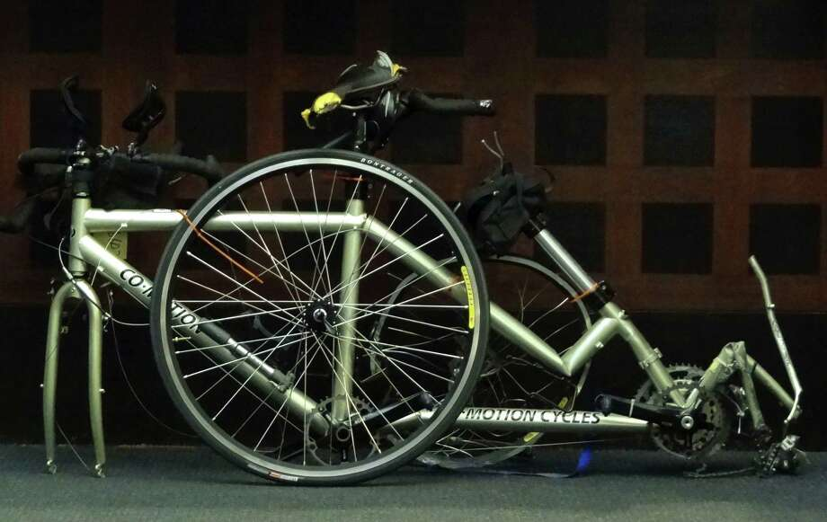 The tandem bicycle on which Gregory and Alexandra Bruehler were hit and killed sits in the courtroom during a hearing in 144th District Court on Wednesday, Sept. 5, 2012. Gilbert John Sullaway hit them with his vehicle three years ago. Photo: Billy Calzada, San Antonio Express-News / © San Antonio Express-News