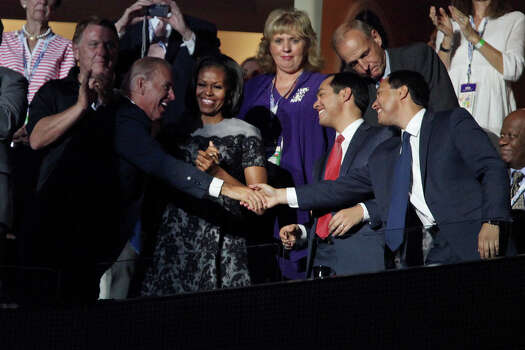 Mayor Julian Castro, right, and his brother, Julian Castro, far right, shake hands with Vice President Joe Biden, left, with First Lady Michelle Obama before former President Bill Clinton's speech during the Democratic National Convention at Time Warner Cable Arena in Charlotte, NC on Wednesday, Sept. 5, 2012. Photo: Lisa Krantz, San Antonio Express-News / San Antonio Express-News
