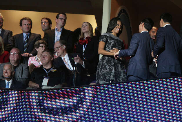 Mayor Julian Castro, center, and his brother, Julian Castro, are greeted by First Lady Michelle Obama as they take their seats next to her for former President Bill Clinton's speech during the Democratic National Convention at Time Warner Cable Arena in Charlotte, NC on Wednesday, Sept. 5, 2012. Vice President Joe Biden is seated, far left. Photo: Lisa Krantz, San Antonio Express-News / San Antonio Express-News