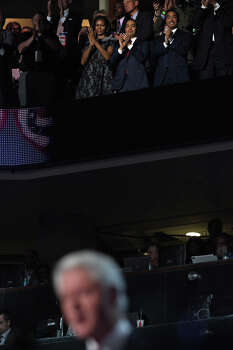 Mayor Julian Castro, center, with his brother, Julian Castro, and First Lady Michelle Obama, left, applaud during President Bill Clinton's speech during the Democratic National Convention at Time Warner Cable Arena in Charlotte, NC on Wednesday, Sept. 5, 2012. Photo: Lisa Krantz, San Antonio Express-News / San Antonio Express-News