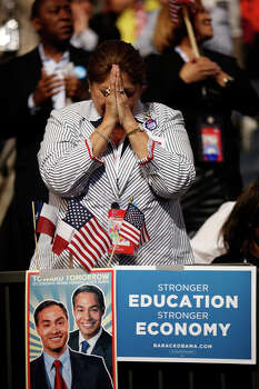 Nancy Garcia, of San Antonio, bows her head at the end of a speech by Sister Simone Campbell, Executive Director of Roman Catholic Social Justice Organization, NETWORK, during the Democratic National Convention at Time Warner Cable Arena in Charlotte, NC on Wednesday, Sept. 5, 2012. Photo: Lisa Krantz, San Antonio Express-News / San Antonio Express-News