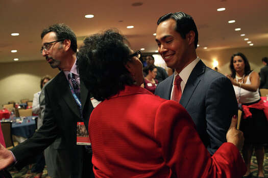 "Mayor Julian Castro is congratulated by Choco Meza of San Antonio during ""A Texas Leadership Salute"" at the Omni Hotel the morning after his keynote speech during the Democratic National Convention in Charlotte, NC on Wednesday, Sept. 5, 2012. Photo: Lisa Krantz, San Antonio Express-News / San Antonio Express-News"