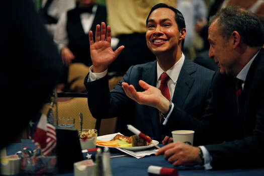 "Mayor Julian Castro waves to a supporter as he sits with Arturo Sarukhan, Mexico's Ambassador to the United States, right, during ""A Texas Leadership Salute"" at the Omni Hotel the morning after his keynote speech during the Democratic National Convention in Charlotte, NC on Wednesday, Sept. 5, 2012. Photo: Lisa Krantz, San Antonio Express-News / San Antonio Express-News"