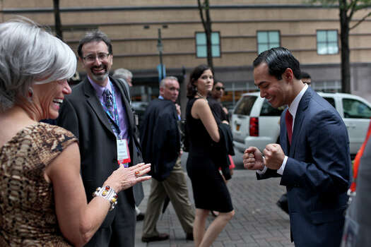 Mayor Julian Castro laughs with Alice Germond, the Secretary of the Democratic National Committee, left, the morning after his keynote speech during the Democratic National Convention in Charlotte, NC on Wednesday, Sept. 5, 2012. Photo: Lisa Krantz, San Antonio Express-News / San Antonio Express-News