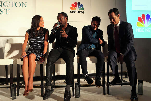 "Mayor Julian Castro, far right, stands after participating in a panel entitled, ""What Is Working"" with actor Rosario Dawson, from left, musician will.i.am and Jeremy Heimans, CEO of Purpose, in a joint event with The Huffington Post, NBC News and Microsoft at The Ritz-Carlton the morning after his keynote speech during the Democratic National Convention in Charlotte, NC on Wednesday, Sept. 5, 2012. Photo: Lisa Krantz, San Antonio Express-News / San Antonio Express-News"