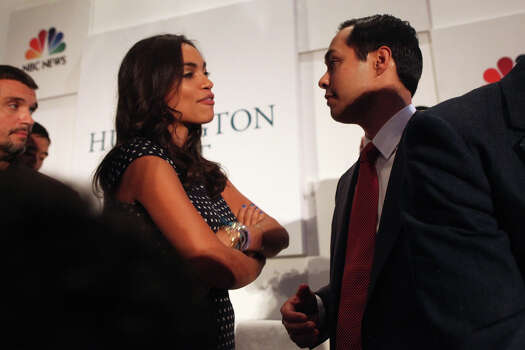 "Mayor Julian Castro, right, talks with actor Rosario Dawson after  participating in a panel with her entitled, ""What Is Working"" a joint event with The Huffington Post, NBC News and Microsoft at The Ritz-Carlton the morning after his keynote speech during the Democratic National Convention in Charlotte, NC on Wednesday, Sept. 5, 2012. Photo: Lisa Krantz, San Antonio Express-News / San Antonio Express-News"