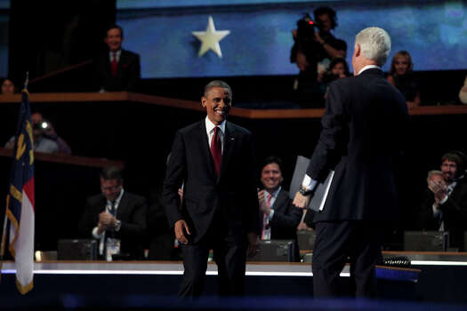 President Barack Obama joins Bill Clinton on stage after Clinton's speech during the Democratic National Convention at Time Warner Cable Arena in Charlotte, NC on Wednesday, Sept. 5, 2012. Photo: Lisa Krantz, San Antonio Express-News / San Antonio Express-News